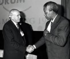 Nelson Mandela shakes hand with white south african government